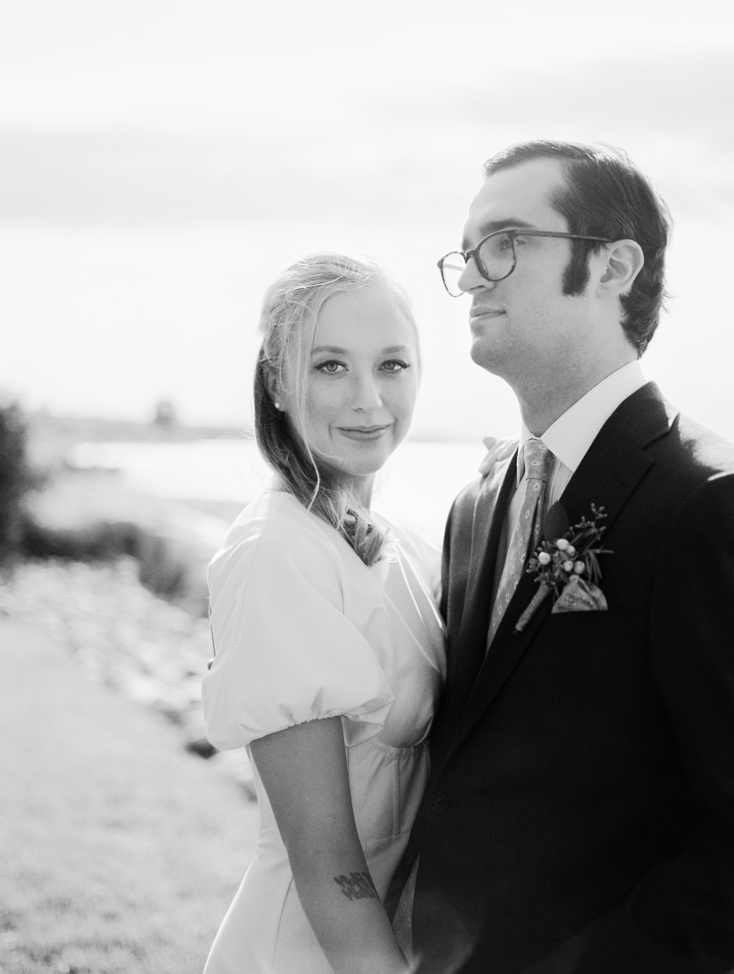 A bride with cat eyeliner wedding makeup looks at the camera during their Petoskey, Michigan wedding