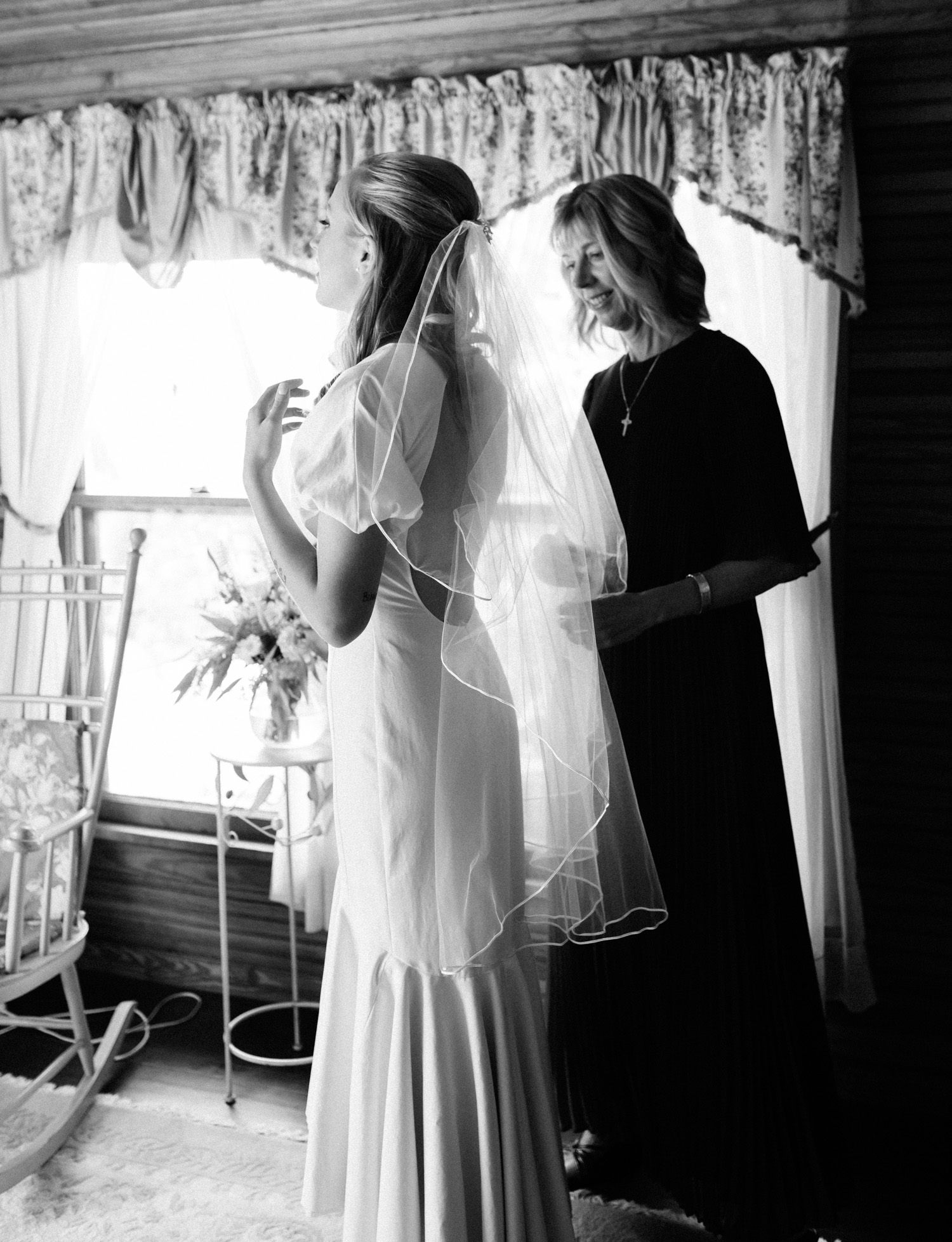 A bride's mother helps her prepare in their family home in Petoskey, Michigan