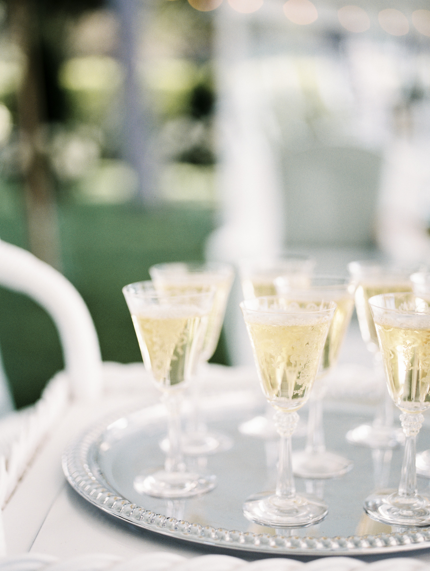 Vintage etched glassware is filled with champagne for a wedding toast in Petoskey, Michigan