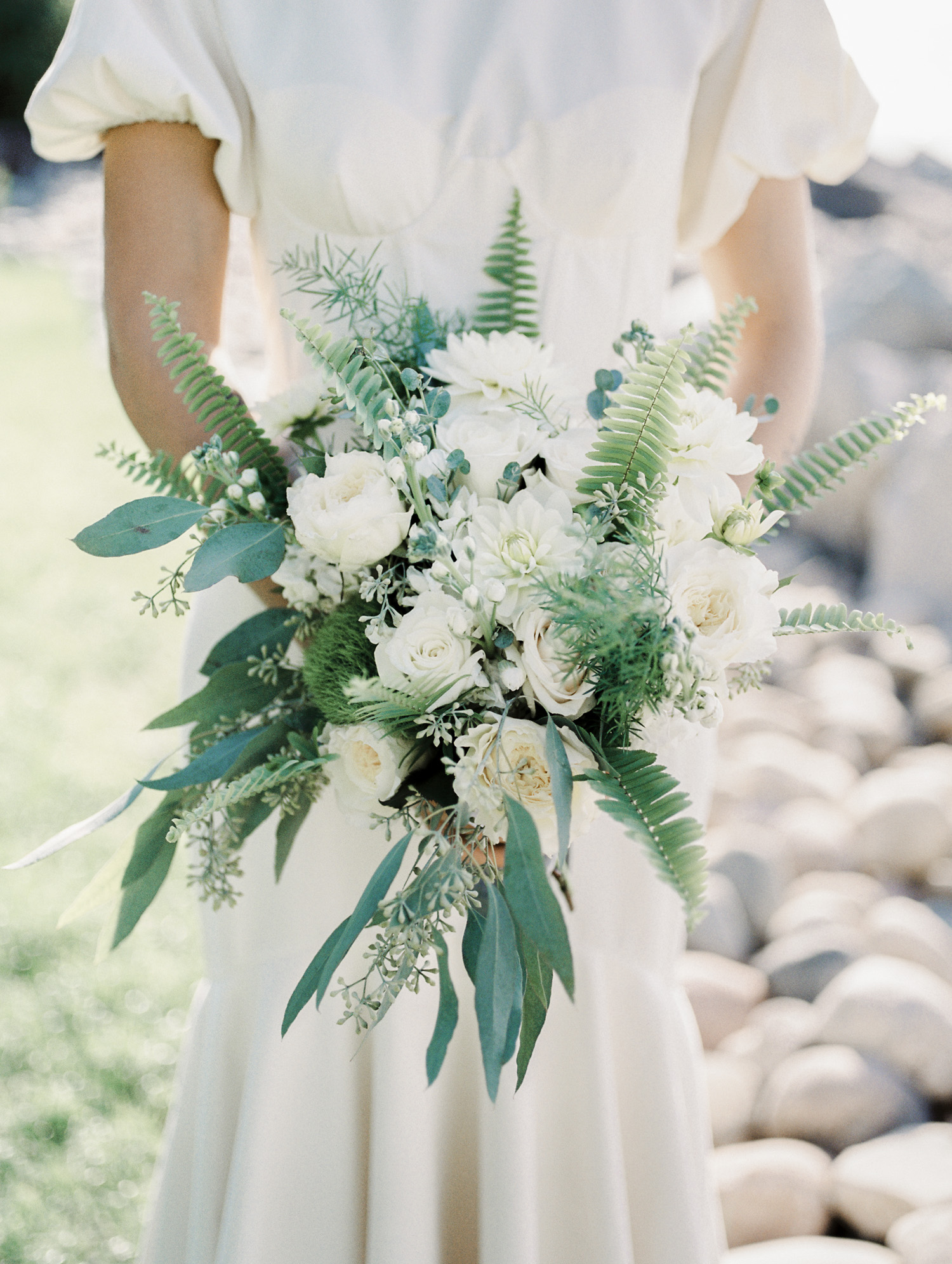 A green and white bridal bouquet with ferns for a wedding in Petoskey, Northern Michigan