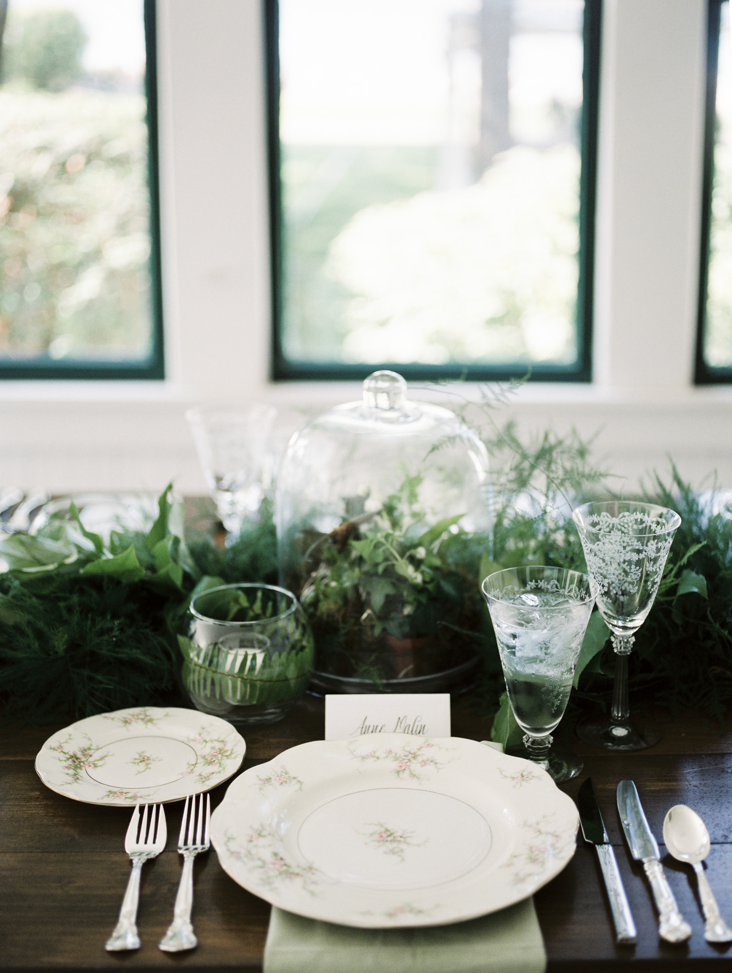 wedding dinner table decor with a cloche and vintage dinnerware in Petoskey, Michigan