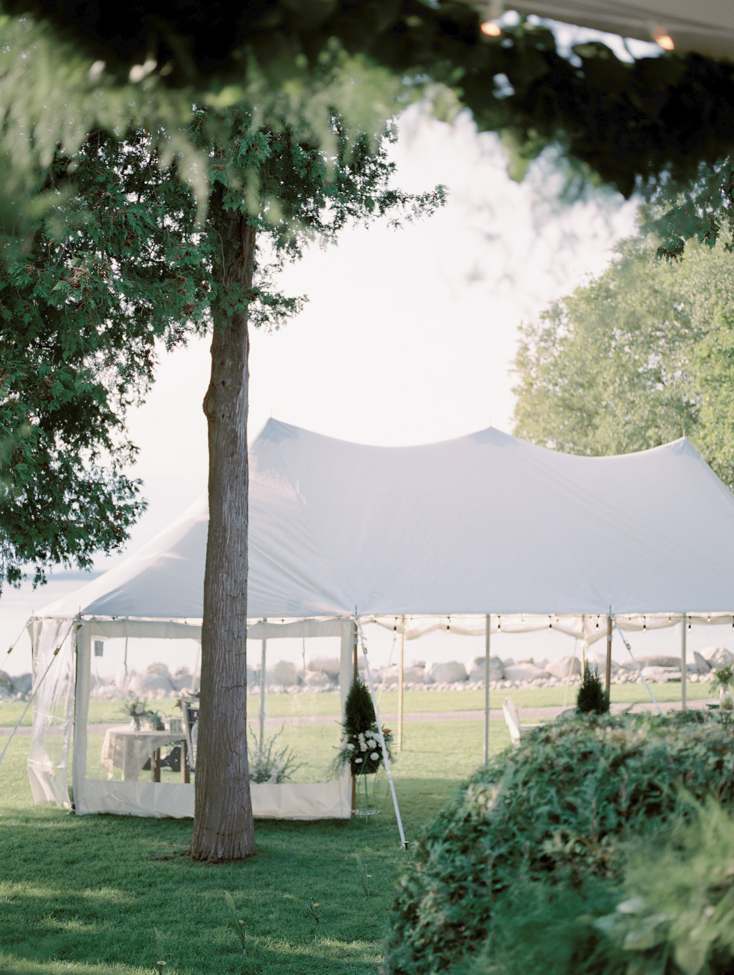 A sailcloth tent for an intimate Petoskey wedding on Lake Michigan