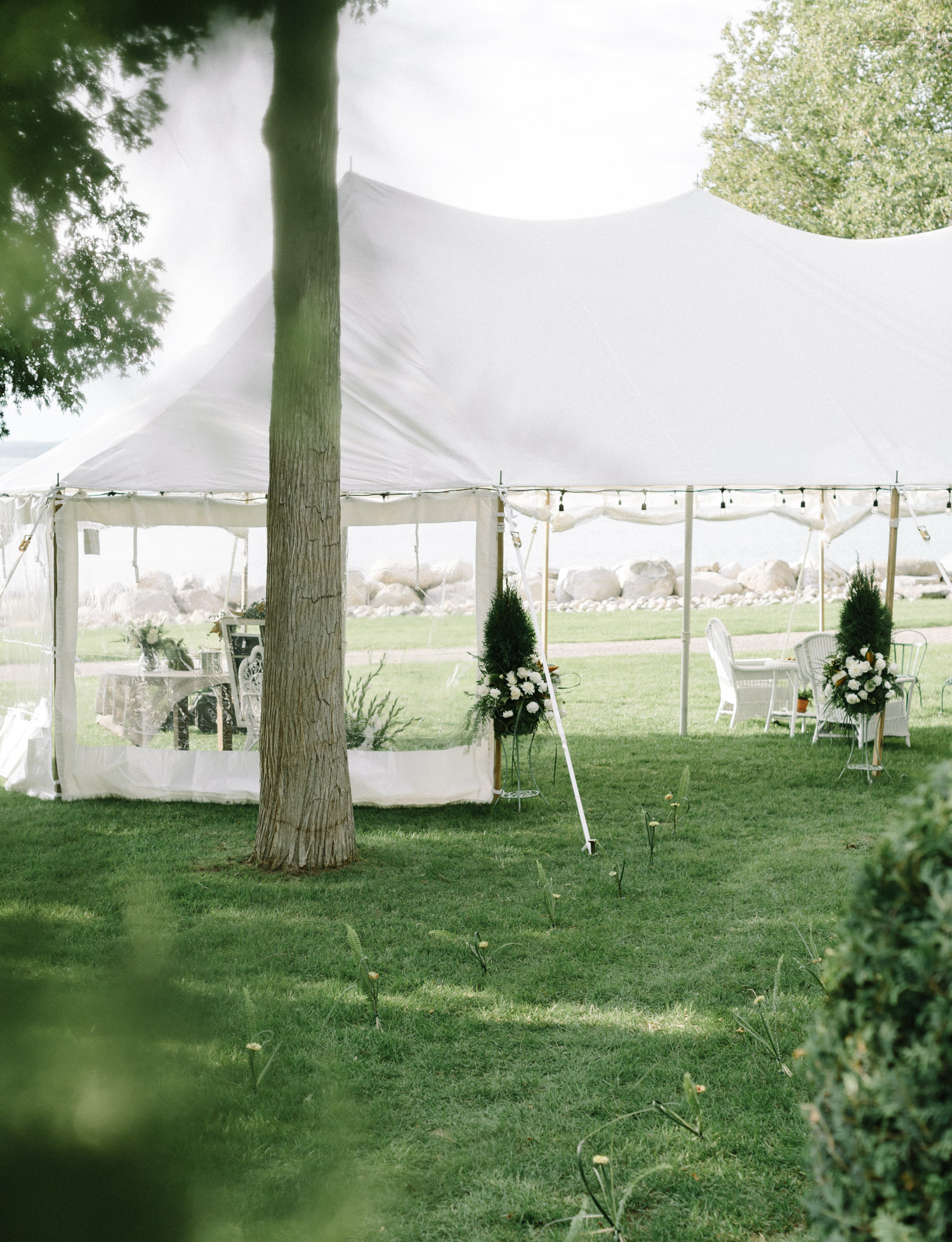 A sailcloth tent for an intimate wedding at a Lake Michigan home in Petoskey, Michigan