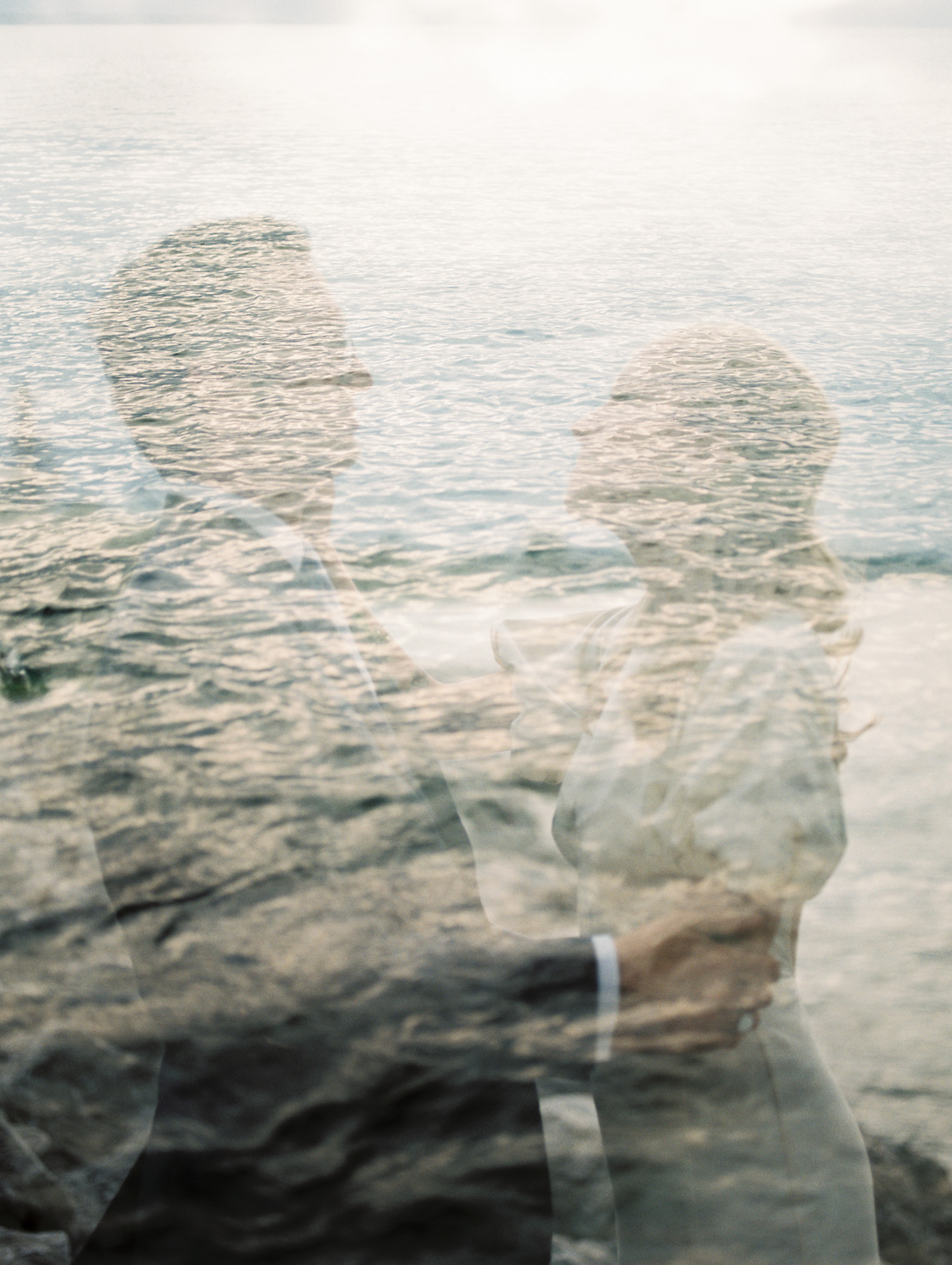 a double exposure film photo of a bride and groom embracing in Michigan