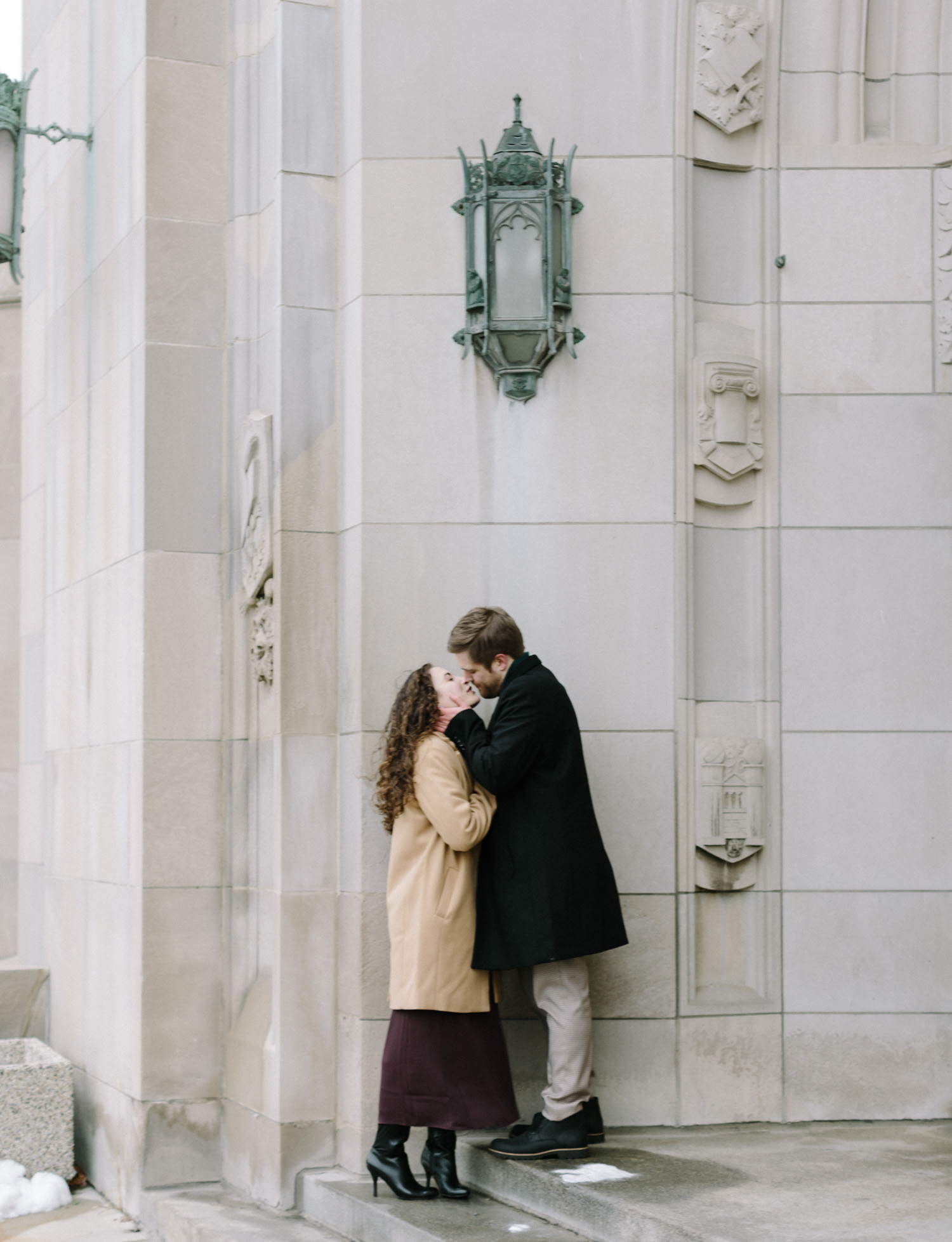 a couple kisses under a lantern at the Masonic Temple in Detroit, Michigan