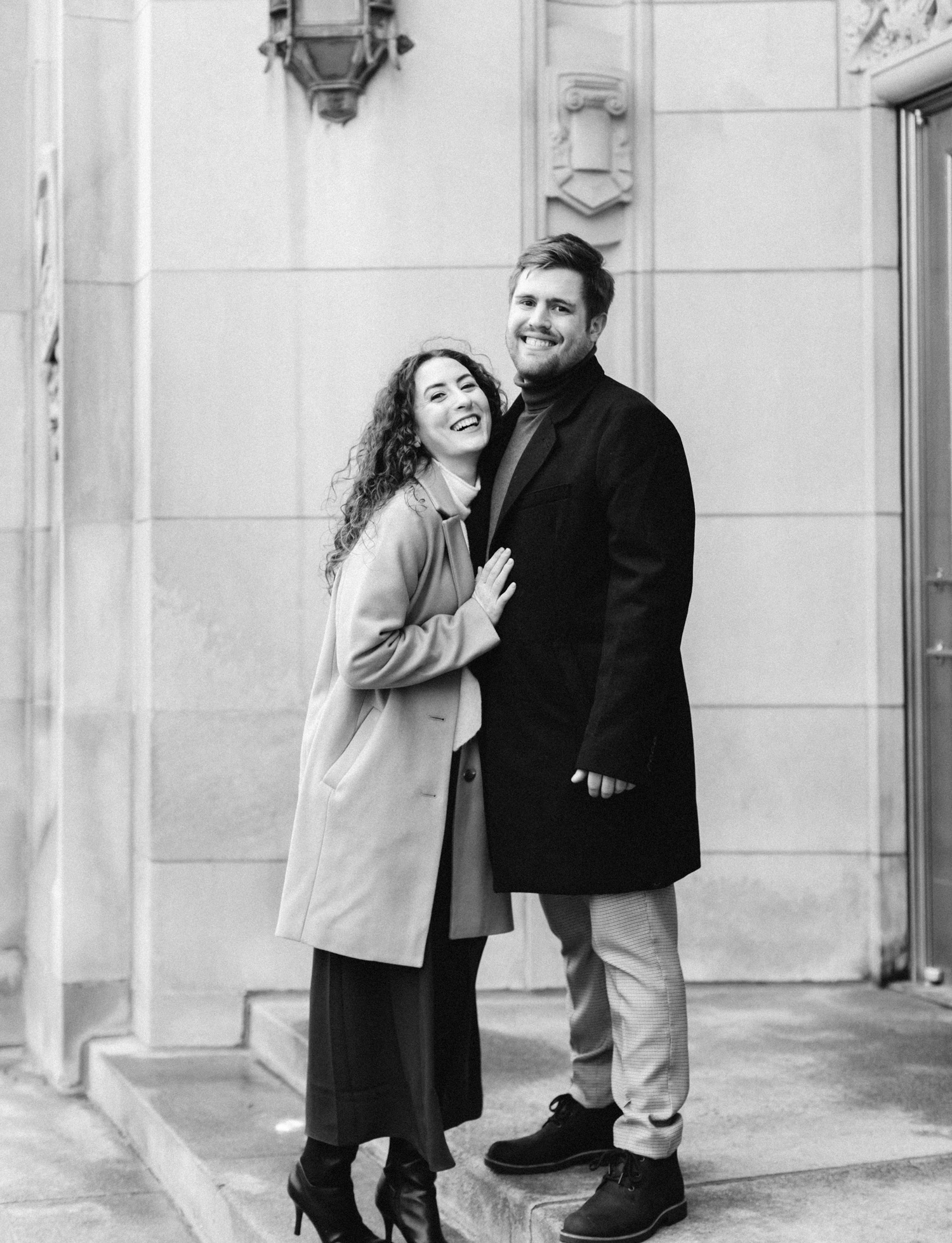 a couple laughs during their masonic temple Detroit engagement photos