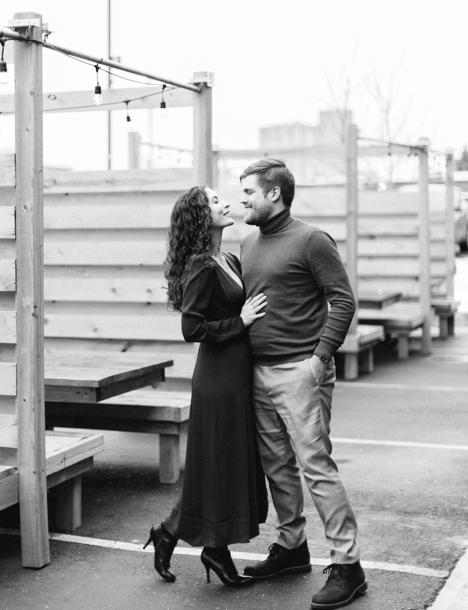 a couple dances playfully during their downtown Detroit engagement photos