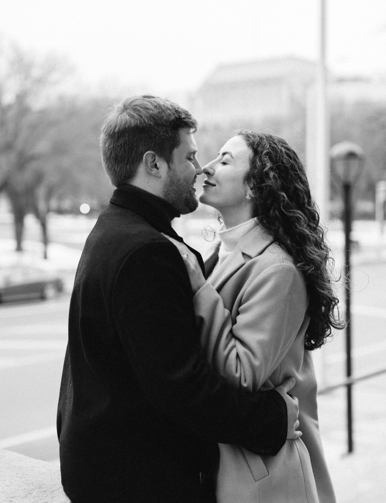 A couple embraces outside the Masonic Temple in Detroit during their engagement photos