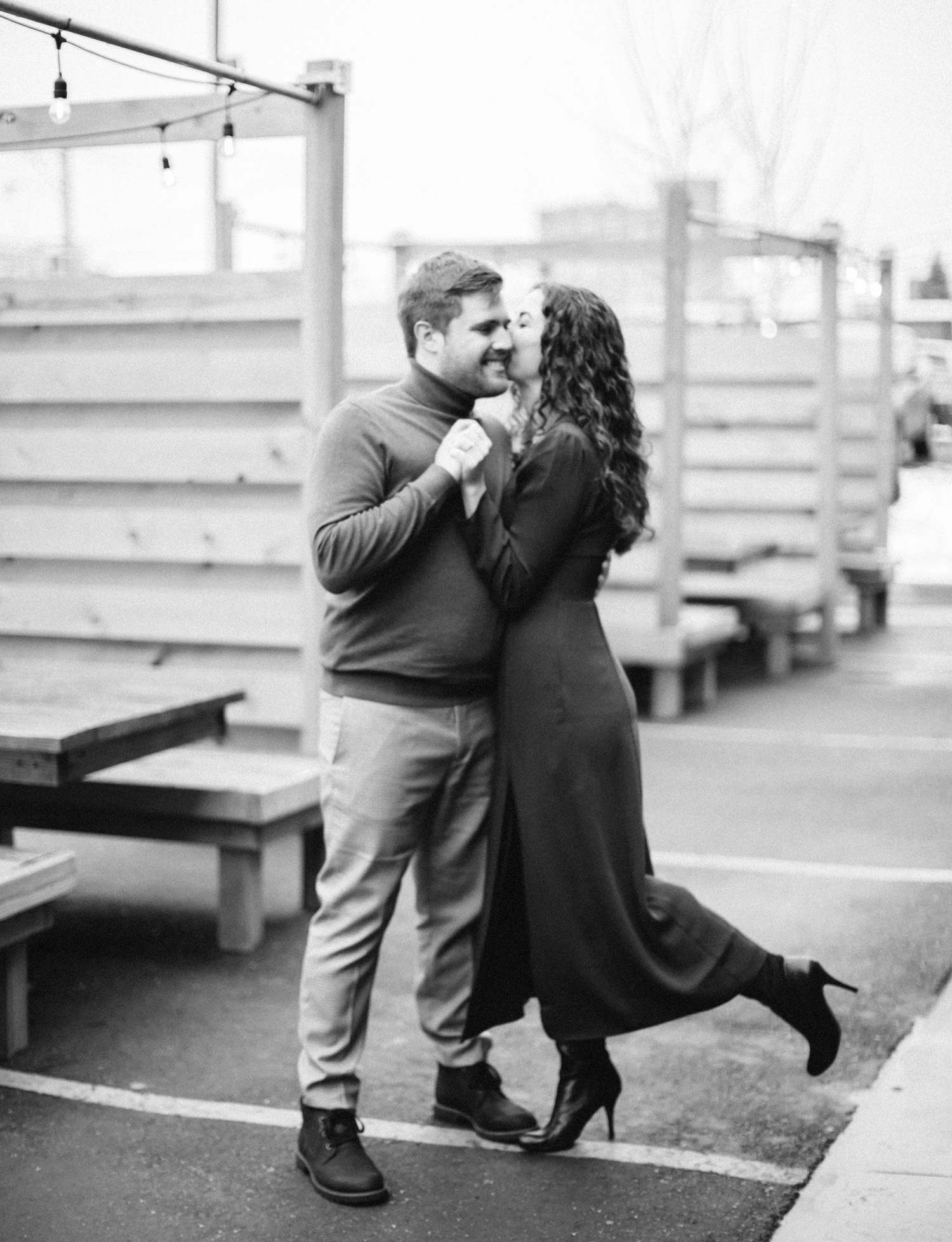 A couple dances at Detroit Shipping Co. during their downtown Detroit engagement photos