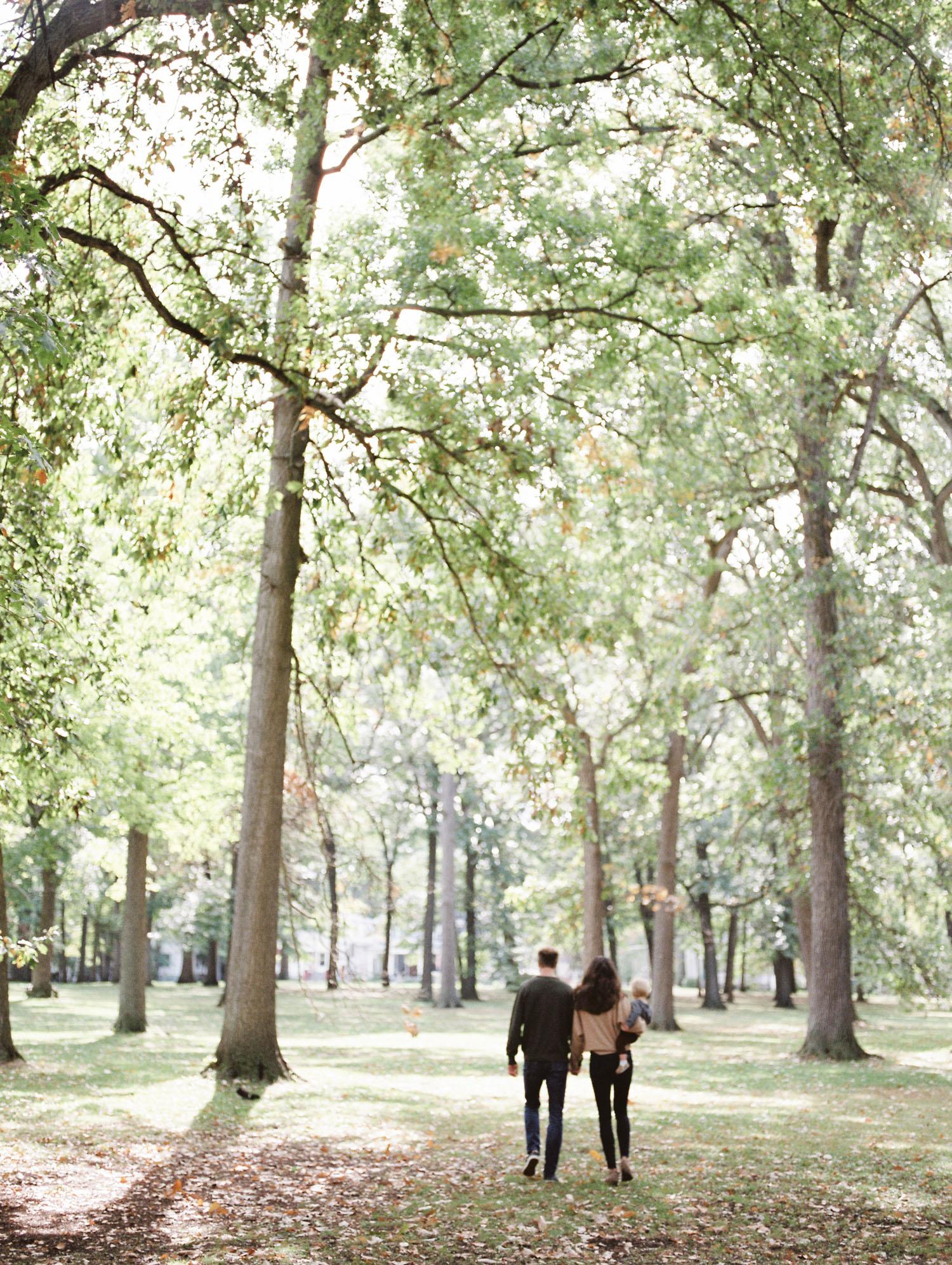 A family walks through a park near their home in Royal Oak, Michigan
